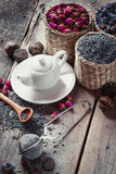 Teapot and herbal tea assortment: lavender, roses, green tea Stock Images