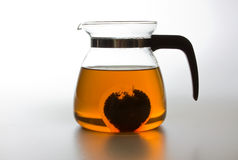 Teapot with hot tea Stock Photos