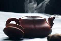 Teapot with hot water Stock Photos