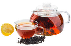 Teapot i filiżanka herbata. Odizolowywający na bielu Obrazy Stock