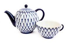 Teapot i filiżanka Obrazy Stock