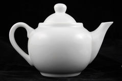 Teapot isolated by black Royalty Free Stock Images