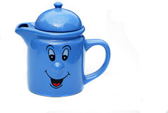 Teapot with a jolly face Stock Photo