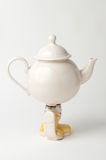 Teapot with legs Royalty Free Stock Photos