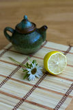 Teapot and lemon. On canvas Stock Photo