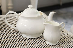 Teapot with little milk jar Royalty Free Stock Photo