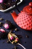 Teapot and loose leaf tea Stock Photo