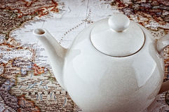 The teapot on the map in a retro style Stock Photos
