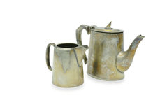 Teapot and milk jug. Old Teapot and milk jug in silver metal on white background Stock Photos