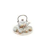 Teapot minúsculo da lembrança com bacias Imagens de Stock Royalty Free