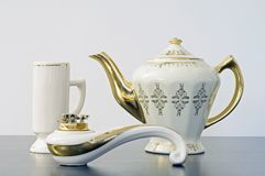 Teapot, mug and lighter Stock Photos