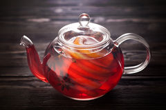 Teapot with mulled wine Stock Images