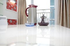 Teapot in a new house Stock Image
