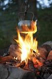 Teapot over campfire Stock Photos