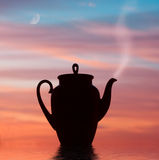 Teapot over sky Stock Photo
