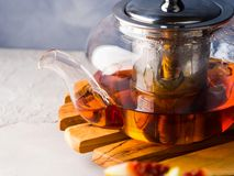 Teapot of red tea and honey Royalty Free Stock Photos