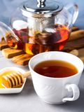 Teapot of red tea and honey Stock Photo