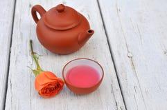 Teapot and rose Stock Photos