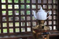 Teapot on samovar Royalty Free Stock Photography