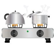 Teapot and saucepan on gas lash Stock Photo