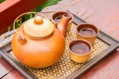 Teapot set. Teapot and teacup on the bamboo mat Royalty Free Stock Image