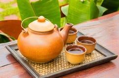 Teapot set. Teapot and teacup on the bamboo mat Stock Images