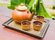 Teapot set. Teapot and teacup on the bamboo mat Royalty Free Stock Images