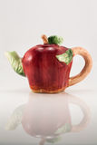 Teapot in the shape of apple on white. The photo shows the teapot in the shape of red apple on white Royalty Free Stock Images