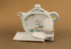 Teapot shape tea bag holder & 3 sizes of teabags Stock Photography