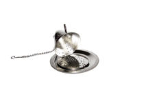 Teapot shaped open tea infuser Stock Images