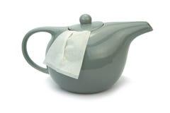 Teapot with tea bag  on white background Stock Photo