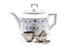 Teapot and tea ball Royalty Free Stock Images