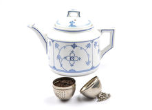 Teapot and tea ball Stock Images