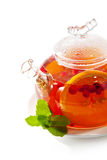 Teapot. Tea with Berries and Orange royalty free stock photography