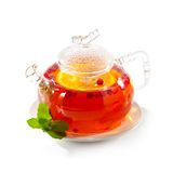 Teapot. Tea with Berries and Orange royalty free stock images