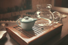 Teapot for tea ceremony. On wooden background stock photography