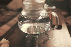 Teapot for tea ceremony. On wooden background stock photo