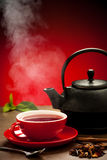 Teapot and tea cup arangement on a table Royalty Free Stock Image