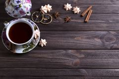 Teapot tea cup on brown wooden table. Teapot tea cup on brown wooden table Stock Images