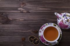 Teapot tea cup on brown wooden table. Teapot tea cup on brown wooden table Stock Photos