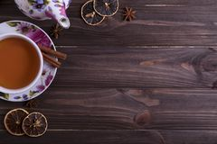 Teapot tea cup on brown wooden table. Teapot tea cup on brown wooden table Royalty Free Stock Photos