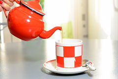 Teapot and tea cup on a gray table Royalty Free Stock Photo