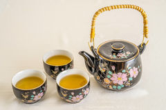 Teapot and tea cups Stock Image