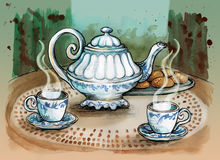 Teapot and tea cups on the table. Stock Photography
