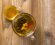 Teapot with tea and honey Stock Images