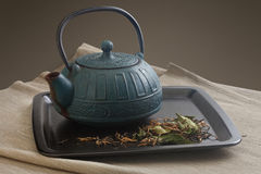 Teapot and tea leaves Royalty Free Stock Photo