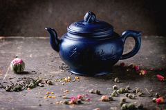 Teapot and tea leaves Stock Photo
