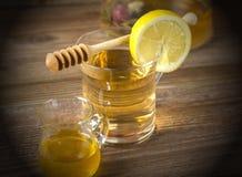 Teapot with tea and lemon slice Royalty Free Stock Photo