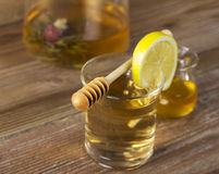 Teapot with tea and lemon slice Royalty Free Stock Photos