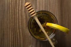 Teapot with tea and lemon slice Stock Image